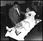 A doctor examines Mickey Mantle at Lennox Hill Hospital in New York after Mickey seriously injures his knee in Game 2 of the 1951 World Series against the NY Giants.