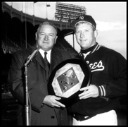 Mickey Mantle accepts his third Most Valuable Player Award from American League President Joe Cronin for his performance with the Yankees in the 1962 season.