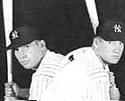 Mickey Mantle poses as a switch-hitter, showing his right-handed and left-handed batting stances