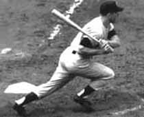 Mickey Mantle smashes at double for the New York Yankees at Yankee Stadium in his rookie season, 1951