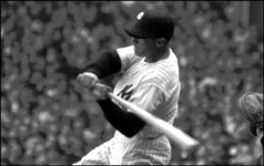 Mickey Mantle slams a home run on July 23, 1957 against the White Sox as he hits for the cycle for the first and only time of his career.