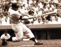 Mickey Mantle's classic right-handed home run power swing, showing Mickey smashing a long right-handed home run at Yankee Stadium in New York