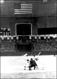 Mickey Mantle awaits the pitch from Astros' pitcher Turk Farrell that he hit for the first home run ever hit in the Houston Astrodome on April 9, 1965.