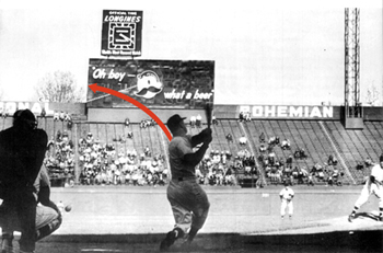 Photo used to demonstrate the path of Mickey Mantle's legendary 565-foot home run he hit at Griffith Stadium in Washington. The red arrow shows the flight of the ball and how it grazed the edge of the National Bohemian auxiliary football scoreboard. In the picture Mickey is batting left-handed, but he hit the home run right handed off Senators' southpaw Chuck Stobbs.