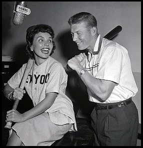 "Mickey Mantle and Teresa Brewer recording the song ""I Love Mickey"" in the recording studio."