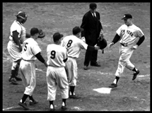 "Mickey Mantle is greeted by Yogi Berra as he crosses the plate after belting his grand slam off Russ ""Monk"" Meyer in Game 5 of the 1953 World Series."